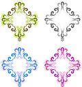 Four diamond shaped vintage frame for photos with a square in the center. Black, blue, green and pink. Royalty Free Stock Photo