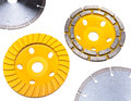 Four different construction diamond disks for concrete processing tile and cutting and abrasion Royalty Free Stock Photo