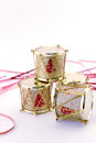Four drums stacked gold conceptual image about christmas christmas decoration with and red ribbon on white background Royalty Free Stock Image
