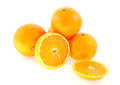 Four entire and one cut mandarin isolated on white background Royalty Free Stock Photo