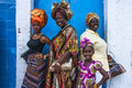 Four female celebrants of Emancipation Day pose against a wall on Picadilly Street, Port-of-Spain, Trinidad on Emancipation Day Royalty Free Stock Photo