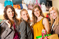 Four female friends shopping bags in a mall Stock Images