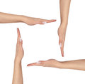Four female hands palm up making square copy space middle isolated white background concept Royalty Free Stock Photos