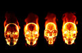 Four fiery flaming skulls
