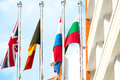 Four flags on flagpoles countries Royalty Free Stock Photos