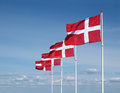 Four flapping danish flags on clear blue sky Royalty Free Stock Image