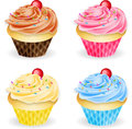 Four flavours of cupcakes a selection fairy cakes chocolate vanilla strawberry and blueberry Royalty Free Stock Photo