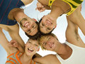 Four friends looking at camera view from below Royalty Free Stock Image
