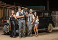 Four gangsters posing group of male and female with guns Royalty Free Stock Photography