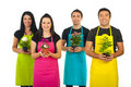 Four gardeners workers offering flowers Royalty Free Stock Photo