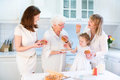 Four generations of women baking apple pie Royalty Free Stock Photo