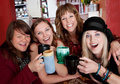 Four girlfriends at a bistro Royalty Free Stock Image