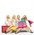 Four girlfriends with a lot of shoppings cheerful Royalty Free Stock Image