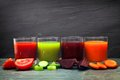 Four glasses of healthy vegetable juice over slate Royalty Free Stock Photo