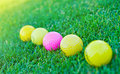 Four golf balls Royalty Free Stock Photos