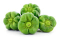 Four green peppers. Royalty Free Stock Photo