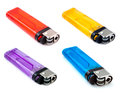 Four half transparent simple lighters red yellow orange purple and bule isloated on white background Royalty Free Stock Photography