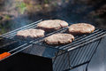Four Hamburgers on Barbeque Grill Royalty Free Stock Photo