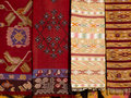 Four hanged handmade traditional wool rugs Royalty Free Stock Photo