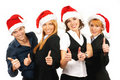 Four happy businesspersons in Christmas hats Royalty Free Stock Photography