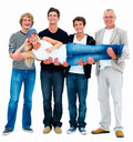 Four happy men carrying a young woman Stock Photography