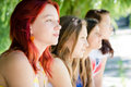Four happy young women girl friends looking together in one direction group of supporters or fans teen Royalty Free Stock Photos