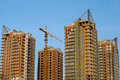 Four high-rise buildings under construction Stock Images