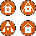 Four houses icons of on the brick wall background Stock Photography