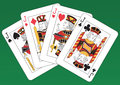 Four jacks poker of playing cards on a green background Royalty Free Stock Photos