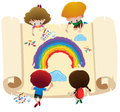Four kids coloring rainbow on big paper Royalty Free Stock Photo