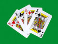 Four kings on green baize background Royalty Free Stock Images