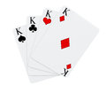 Four kings playing cards suits on a white background Stock Images