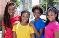 Four laughing african american girlfriends in the city Royalty Free Stock Photo