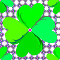 Four leaf clover on floral background a symbol of st patricks day in a seamless pattern a of dainty flower shapes composed of tiny Royalty Free Stock Photo