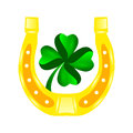 Four leaf clover in horseshoe