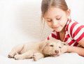 Four legged friend child gently embracing Stock Images