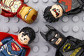 Four Lego Super Heroes minifigures on gray baseplate Royalty Free Stock Photo