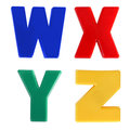 Four letters written in multicolored plastic kids letters Royalty Free Stock Image