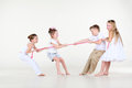 Four little boy and girls in white clothes draw over rope Royalty Free Stock Photos