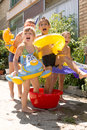 Four little children splashing and having fun Royalty Free Stock Photo