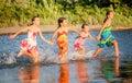 Four little girls having fun in the water in Ada bojana, Montene Royalty Free Stock Photo