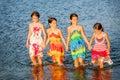 Four little girls having fun in the water on Ada bojana, Montene Royalty Free Stock Photo