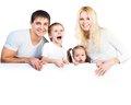 Four members family near white banner Royalty Free Stock Photography