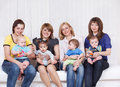 Four mothers with toddlers Royalty Free Stock Photo