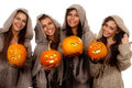 Four nuns holding halloween pumpkins Royalty Free Stock Image
