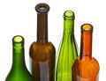 Four open bottlenecks of colored wine bottles isolated on white background Royalty Free Stock Photo