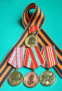 Four orders medals at gerogievskoy tape glory Stock Images