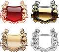 Four Ornate Red  Heraldry Shields Stock Photo