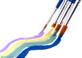 Four paint brushes with pleasing pastel color paint on white background Royalty Free Stock Photos