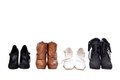 Four pairs different shoes Stock Photography